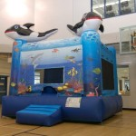 Inflatable Rentals  Under the Sea Inflatable Come jump with your friends under the sea. Dolphins, fish and whales -­‐ who knows who you will meet? Bright colors and aquatic images make this bounce house a great choice for Pirate or any water themed party. $155/$175/$195 (4/6/8 hrs respectively) 13'(W) x 13'(L) x 14'(H)